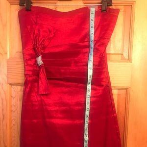 Papaya red short cocktail dress .